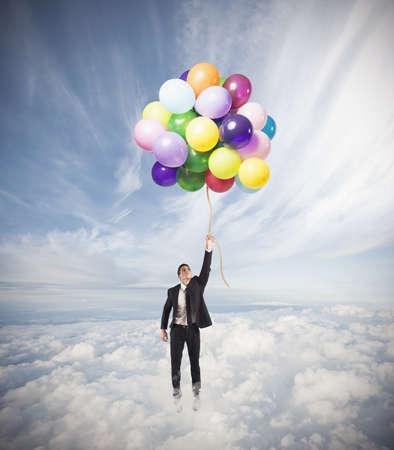 lightness: Businessman flying high concept of success