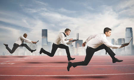 competitive business: Competition in business concept with running businesspeople