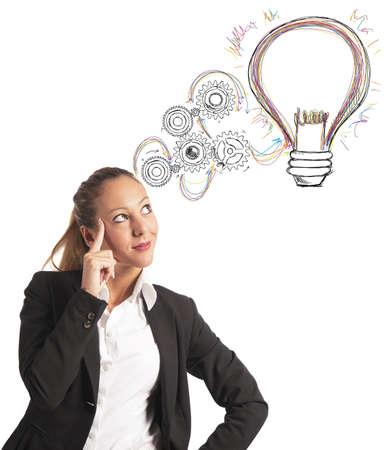 aspirations ideas: Concepto de la construcci�n de una idea de una mujer de negocios Foto de archivo
