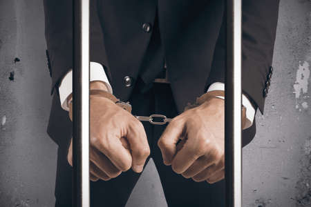 outlaw: Concept of handcuffed businessman in jail Stock Photo