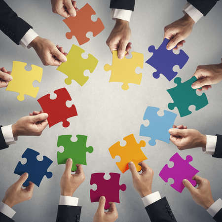 merging: Teamwork and integration concept with puzzle pieces