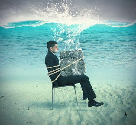 ロープが付いている椅子に閉じ込められた実業家 写真素材