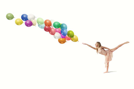 Young girl dance with colorful balloons Stock Photo - 21393491