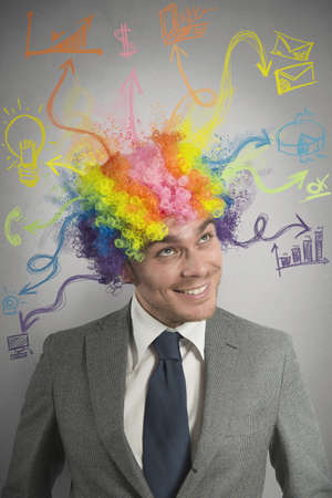 business challenge: Concept of creative businessman with colorful hair