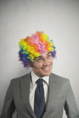 Concept of creative businessman with colorful hair photo