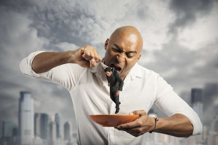 avid: Hungry businessman eating a competitor