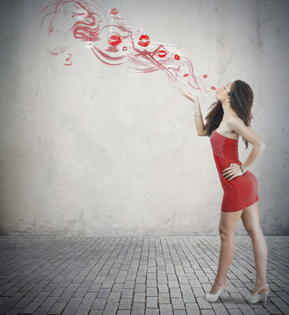 Young fashion girl with red kiss photo