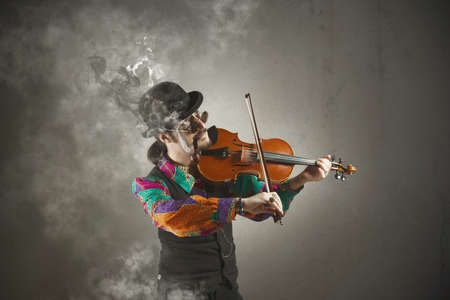 solo violinist: Violinist with pipe surrounded by smoke