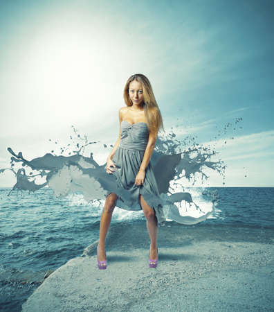 Creative fashion girl against the ocean photo