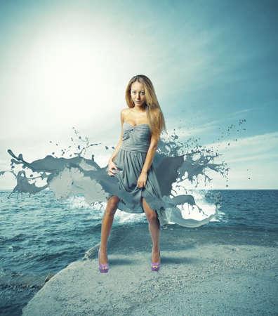 dress: Creative fashion girl against the ocean