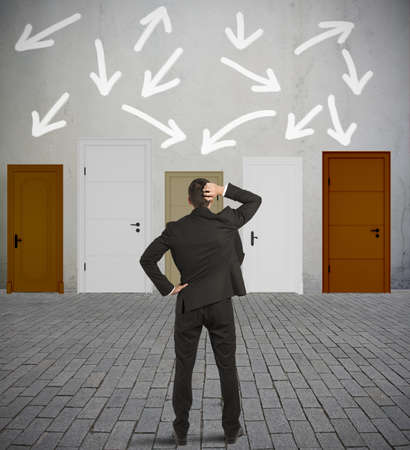 knock: Concept of confused businessman with different doors Stock Photo