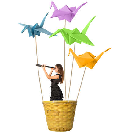 Girl searching for new fashions with origami Stock Photo - 21512342