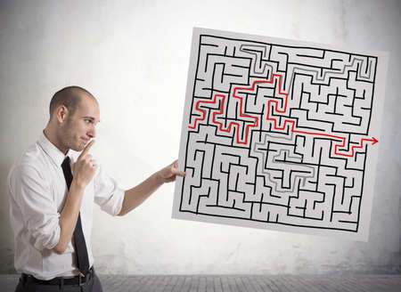Businessman finding solution for the maze Stock Photo