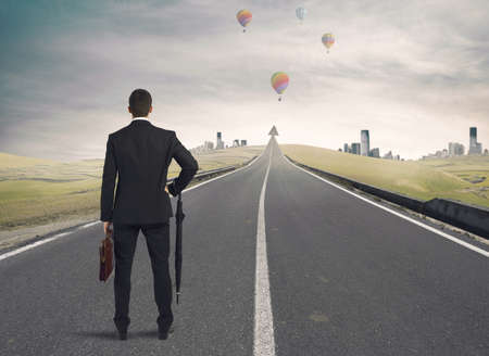Businessman looking the road to success photo