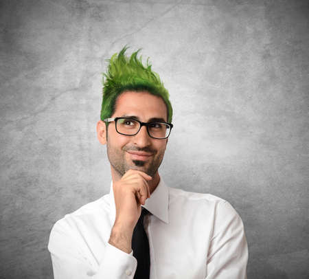 exalted: Concept of creative businessman with green hair Stock Photo