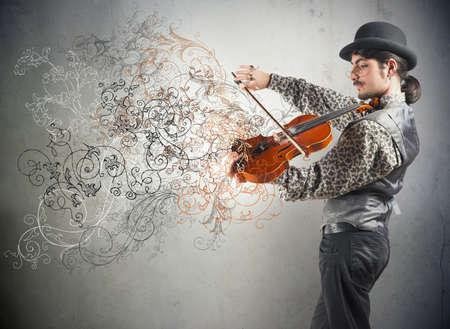 빈티지 꽃 효과가있는 젊은 바이올리니스트