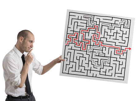 Businessman finding solution for the maze Stock Photo - 21694743