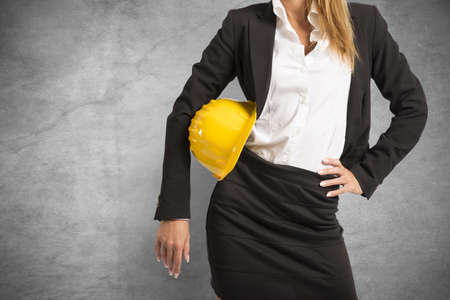 Concept of woman at work with yellow helmet Stock Photo - 21694748