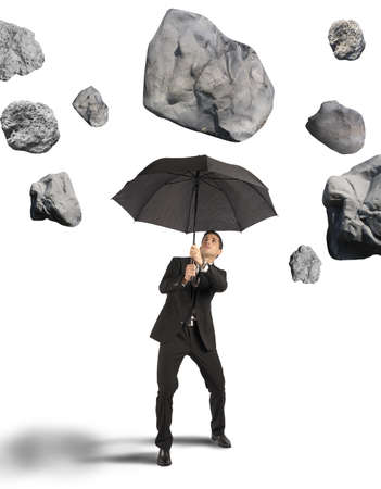 scared man: Businessman shelters from the storm of crisis Stock Photo
