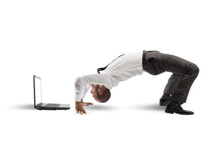 Concept of acrobatic business with man and laptop Stock Photo - 22070308