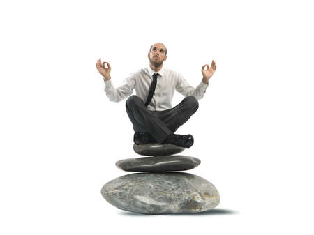 stress free: Concept of relax of a businessman on the stone