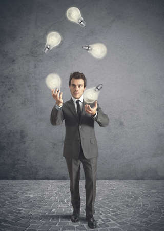 Concept of genius businessman like a juggler photo