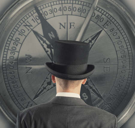 Concept of business direction with businessman and compass photo
