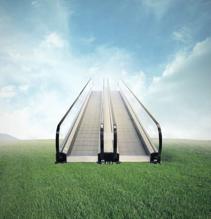 Concept of easy opportunity to success with escalator in a field photo