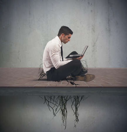Concept of internet addiction with businessman with root photo