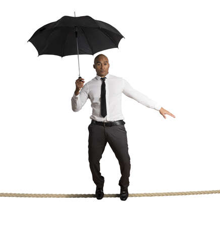 Concept of risk in business with businessman on the rope photo