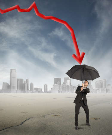 Crisis concept with the businessman who protects himself with umbrella Stock Photo - 22397434