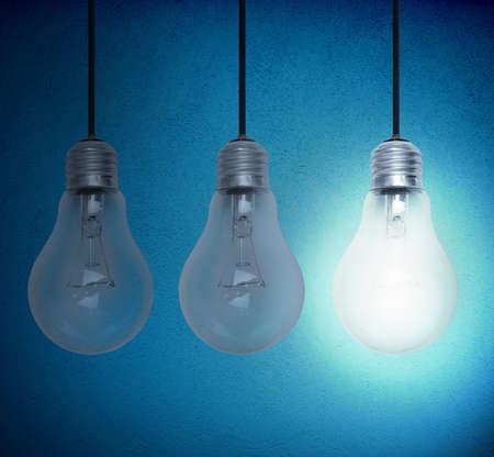 lighting equipment: Concept of idea with illuminated lighbulb on a dark room Stock Photo