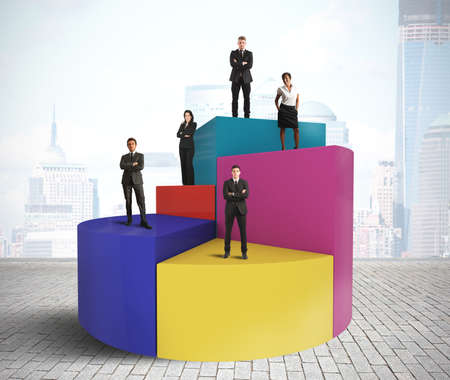 Concept of business team on a pie chart Stock Photo