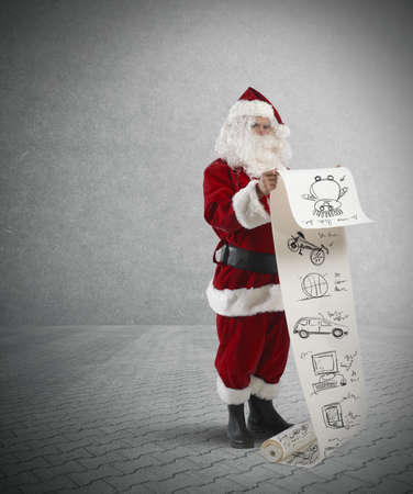 christmas costume: Concept of Santa Claus with gifts list Stock Photo