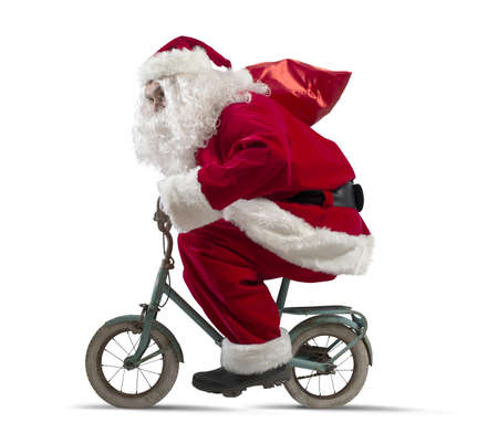 christmas costume: Santa claus on the bike on white background Stock Photo