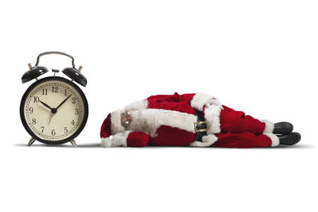 ironic: Concept of tired Santa Claus asleep lying on the ground Stock Photo