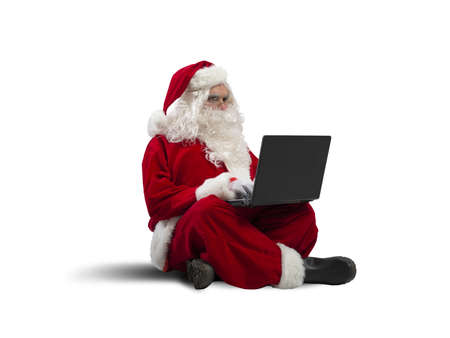 claus: Concept of modern Santa Claus with laptop