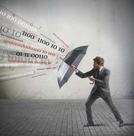 weather protection: Antivirus and firewall concept with businessman and umbrella Stock Photo