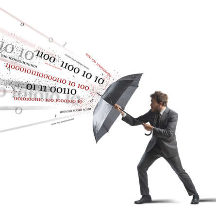 safeness: Antivirus and firewall concept with businessman and umbrella Stock Photo