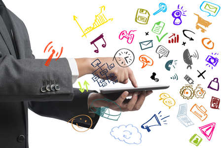 Businessman working with tablet and social media with modern sketch symbol photo