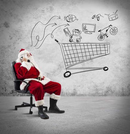 산타 클로스: 전화 및 쇼핑 카트의 그림 산타 클로스