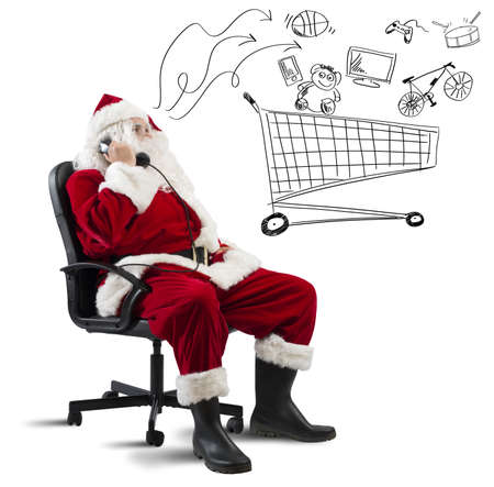 Santa Claus with telephone and drawing of shopping cart Stock Photo - 22635694