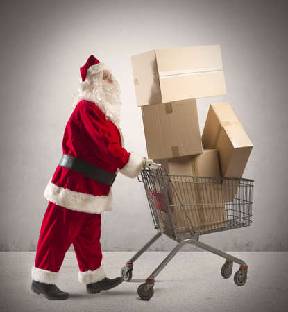 superstore: Santa claus with shopping cart full of packages Stock Photo