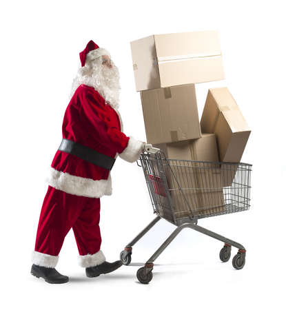 Santa claus with shopping cart full of packages photo