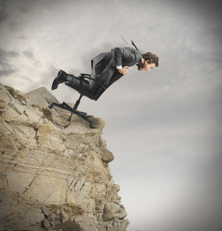 Concept of crisis and financial disaster with businessman in a mountain Stock Photo - 22638128
