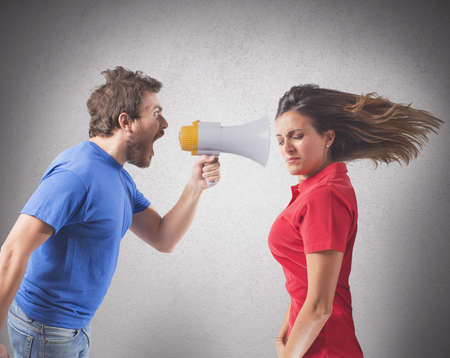 Concept of couples fight with screaming on the megaphone Stock Photo - 22638130