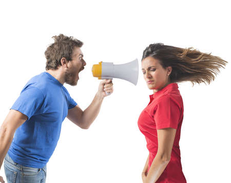 disgruntled: Concept of couples fight with screaming on the megaphone