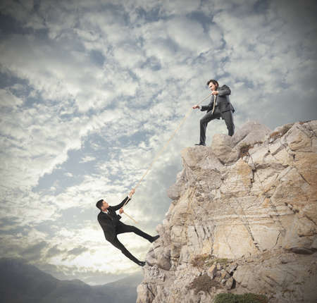 Concept of teamwork with climbing businessman photo