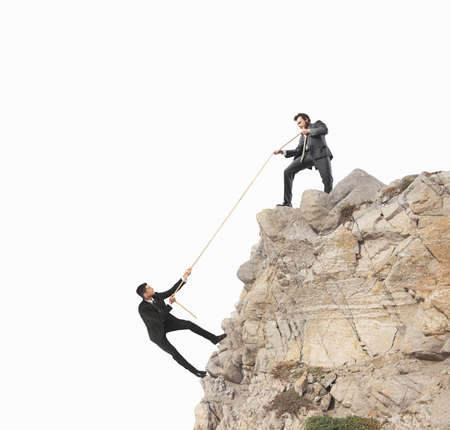 climbing: Concept of teamwork with climbing businessman