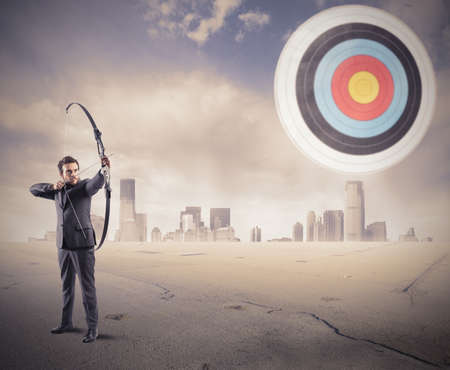 Determinated businessman and Hit the target concept